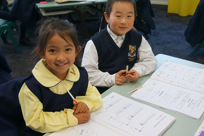 Back into a busy Third Term for 6th class - image children-spelling on https://www.johncolet.nsw.edu.au
