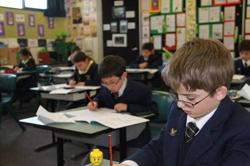 Students take to maths - image Mathscompdaniel on https://www.johncolet.nsw.edu.au